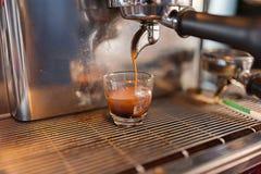 Espresso Shot at the machine. Fresh Espresso Shot at the espresso machine Royalty Free Stock Photos