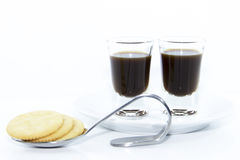 Espresso shots on white plate with cracker Stock Images