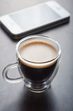 Espresso and smart phone Royalty Free Stock Images