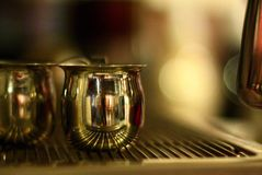 Espresso steaming pitchers. Coffee shop reflection steamer latte mocha cappuccino Royalty Free Stock Photo