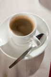 Espresso strong and rich. Cup of espresso coffee on table Stock Photography