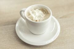 Espresso with Whipped Topping in White Cup on Saucer Royalty Free Stock Photo
