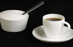 Espresso in white cup. Shot of espresso coffee and sugar bowl on a black background Stock Photography
