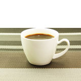 Espresso in white cup on tablemat Stock Photography