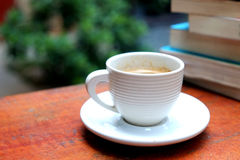 Espresso in the white cup on wood table Royalty Free Stock Image
