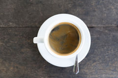 Espresso in white cup. On wooden table Royalty Free Stock Photography