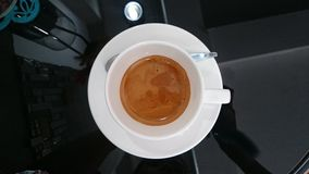 Espresso on the wood table. Royalty Free Stock Image