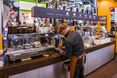 Espressobar. Amsterdam, Holland, January 15, 2015: Espressobar with employee seen from the back, working at the coffeemachine Stock Photo