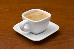 EspressoKaffeetasse auf Tabelle Lizenzfreies Stockbild