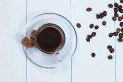 Espressokopp kaffe, socker och bönor Arkivbilder