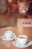 Espressos in a cafe. Two espresso coffees on a table in a restaurant Royalty Free Stock Images