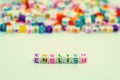 Esprima il ` inglese del ` dalle perle della lettera per l'apprendimento del concetto Immagine Stock