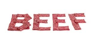 Esprima il MANZO presentato con le fette della salsiccia nella prospettiva Fotografie Stock Libere da Diritti