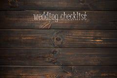 Esprima la lista di controllo di nozze scritta su un piatto di legno Fotografia Stock