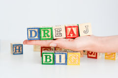 """Esprime il  del big†del """"dream compitato con i cubi di legno della lettera Fotografia Stock"""