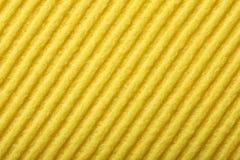 Espuma amarilla de la esponja como textura del fondo Fotografía de archivo libre de regalías