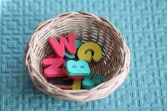 Espuma colorida do alfabeto na cesta Imagens de Stock Royalty Free