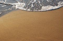 Espuma da areia e do mar Fotos de Stock Royalty Free