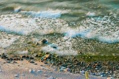 Espuma das ondas no mar Imagem de Stock Royalty Free