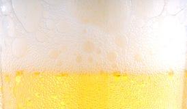 Espuma de la cerveza Fotografía de archivo