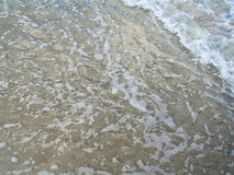 Espuma de la orilla Foto de archivo libre de regalías