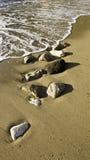 Espuma de la playa Foto de archivo libre de regalías
