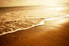 Espuma de oro del mar Fotografía de archivo