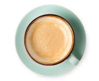 Espuma del capuchino, opinión superior de la taza de café sobre el fondo blanco Imágenes de archivo libres de regalías