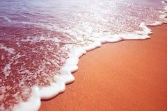 Espuma del mar de una onda Foto de archivo