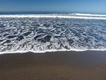 Espuma e ondas do mar fotografia de stock