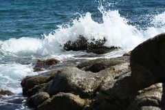 Espuma en las ondas Foto de archivo libre de regalías