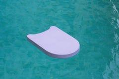 Espuma flotante que nada Fotografía de archivo libre de regalías