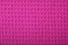 Espuma rosada de la esponja como textura del fondo Imagenes de archivo