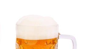 Espuma superior na caneca de cerveja Imagens de Stock