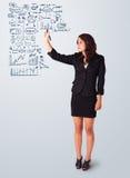 Esquema e iconos del negocio del dibujo de la mujer en whiteboard Fotos de archivo