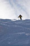 Esquiador amarelo fotografia de stock