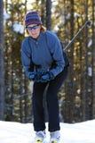 Esquiador del país cruzado en los árboles Fotos de archivo