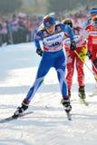 Esquiador finlandés en la raza de Milano en la ciudad Fotografía de archivo