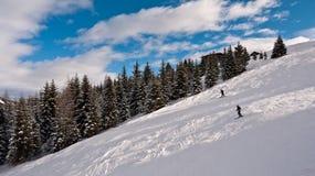 Esquiadores nas inclinações do esqui do olímpico Foto de Stock Royalty Free