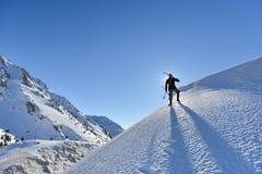 Esquiadores & silhueta dos esquiadores Imagens de Stock