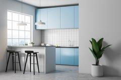 Esquina blanca de la cocina de la teja, encimeras azules stock de ilustración
