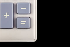 Esquina y botones de la calculadora en fondo negro Fotografía de archivo libre de regalías