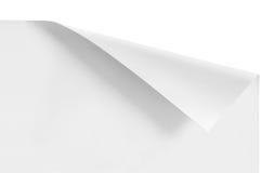 Esquinas encrespadas del papel blanco de la hoja Imágenes de archivo libres de regalías