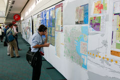 ESRI User Conference 2010 - Person Reviewing Maps. SAN DIEGO - JULY 12: ESRI (Environmental Systems Research Institute) user conference is the biggest GIS ( royalty free stock photos
