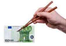 Ess-Stäbchen mit Banknote 1 Stockbilder