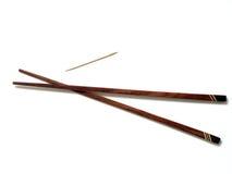 Ess-Stäbchen mit einem Toothpick stockbild
