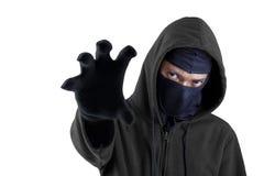 Essai masculin de voleur pour voler quelque chose Photos stock