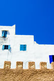 Essaouira architecture, Morocc. Essaouira architecture with its classic white wall and blue window, Morocco Stock Photos