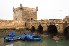 Essaouira Fortress, Morocco. Essaouira, Morocco: harbour fortifications with the Essaouira city in the background. Harbour fortifications were built by an Royalty Free Stock Image