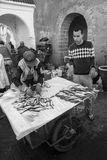 Essaouira, Morocco - January 8, 2017: Fisherman at Essaouira`s market. Two men are selling fish on the streets of Essaouira Stock Photo